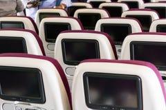Touristenklasse-Flugzeuginnenraum Stockbilder