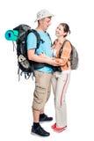 Touristes affectueux actifs dans une hausse, photo sur un blanc Image stock
