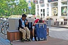 Touristes de repos Photos libres de droits