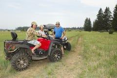 Touristes sur les véhicules tout-terrain Sur ATV Photos libres de droits