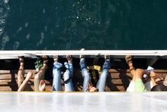 Touristes sur un bateau Photos libres de droits
