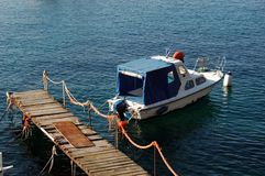 Touristic boat. Alone and old touristic boat on sea port Stock Photography