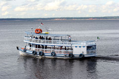 Touristic boat on amazon river Stock Images