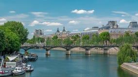 Touristic boat passes below Pont des Arts, on boat station on Seine river timelapse in Paris.