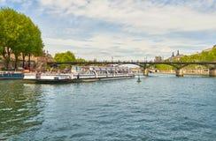 Touristic boat passes below Pont des Arts on Seine river in Pari Stock Photos