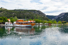 Touristic boat and swans in Skradin, Croatia Royalty Free Stock Images