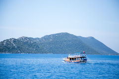 Touristic boat with Turkish flag in Mediterranean seascape Royalty Free Stock Image