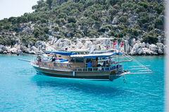 Touristic boat with Turkish flag in Mediterranean seascape Royalty Free Stock Images