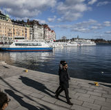 Touristic boats/hotel buildings/blue skies/people walking, Stockholm. Royalty Free Stock Photography