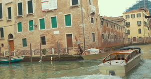 Touristic boats sailing on canal of Venice stock footage