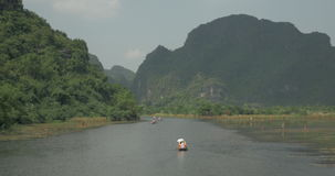 Touristic boats in Trang An, Vietnam stock video footage