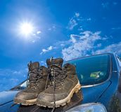 Touristic boots on  a car Royalty Free Stock Photo
