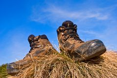 Touristic boots in a grass Royalty Free Stock Photos