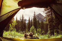 Touristic boots near a camp. Beautiful view from the tent. Travel lifestyle Royalty Free Stock Photos