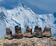 Touristic boots on a rock Stock Photos