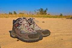 Touristic boots on a sand Royalty Free Stock Photography