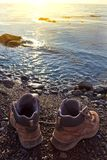 Touristic boots on a sea coast Royalty Free Stock Photo