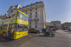 Touristic Bus. Hop on-hop off touristic bus on the streets of Paris Royalty Free Stock Image