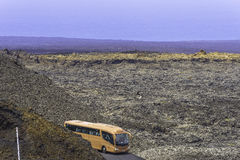 Touristic bus in the Timanfaya. Touristic bus at the time of the presentation Mountains of fire,Timanfaya, Lanzarote National Park, Canary, Spain Stock Photos