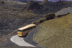 Touristic bus in the Timanfaya. Touristic bus at the time of the presentation Mountains of fire,Timanfaya, Lanzarote National Park, Canary, Spain Royalty Free Stock Image