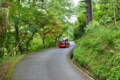 Touristic bus with tourists on excursion tour in botanical garden Georgia Batumi Stock Photo