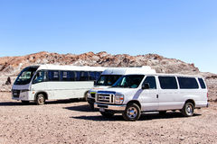 Touristic buses in desert Stock Photography