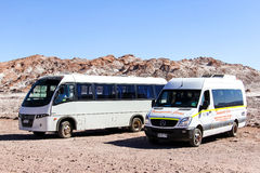 Touristic buses in desert Stock Photo