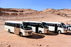 Touristic buses in desert Stock Photos