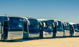 Touristic buses. In a row Royalty Free Stock Photos