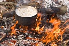 Touristic caldron. In a fire stock photos