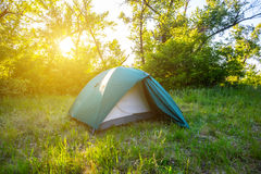 Touristic camp in a forest. At the sunset Stock Images