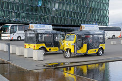 Touristic cars. Touristic cars in front of Harpa concert hall Royalty Free Stock Photo