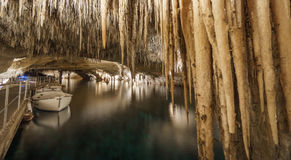 Touristic Cave with lake, stalactites and stalagmites Royalty Free Stock Photos