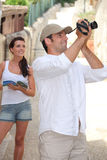 Touristic couple. A touristic couple with camera Stock Images
