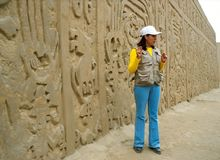 Touristic guide and wall carving Royalty Free Stock Photography