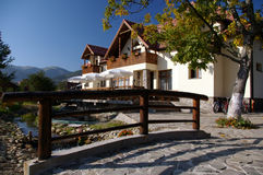Touristic house in Romanian mountains. On a beautiful sunny morning Royalty Free Stock Photos