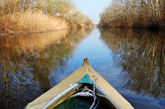 Touristic kayak on the river. Touristic kayak floats in the middle of  the river Stock Images