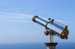 Touristic Metal Spyglass on the sky background Royalty Free Stock Image