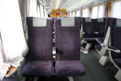 Touristic passenger train interior. Seating on the interior of a modern passenger train royalty free stock photo