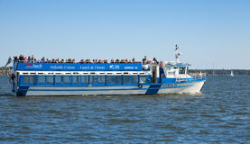 Touristic pleasure boat sails in the harbor of Helsinki Stock Photos