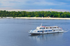 Touristic river boat. A touristic boat heading towards river port in Kiev, Ukraine Royalty Free Stock Photography