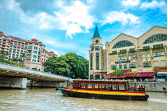 Touristic river boat on a river in Singapore Stock Photography
