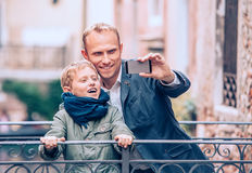 Touristic selfie - father and son take a picture with a smartpho Stock Photo