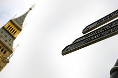 Touristic signs in London. Some touristic signs in London, with the Big Ben tower on the background Stock Photo