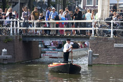 Touristic spectacle in Alkmaar, Holland. During the Cheese Market in the dutch town of Alkmaar a skipper transports the cheeses by boat through the water of the Stock Images