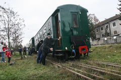 Touristic steam engine train. Brad, Romania, December12, 2009: Mechanics are pushing an old steamed cog train in Brad, on winter holydays Royalty Free Stock Images