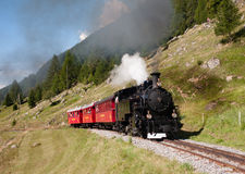 Touristic Steam Train In Alps In Switzerland Stock Photography