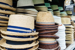 Touristic street market selling hats Stock Photos