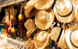 Touristic street market selling souvenirs in Cuba. Street market selling hats and souvenirs in the touristic town of Varadero in Cuba photographed with a shallow Royalty Free Stock Images