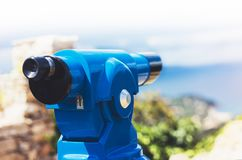 Touristic telescope look at the city Barcelona Spain, close up metal binoculars on background viewpoint overlooking the mountain royalty free stock image